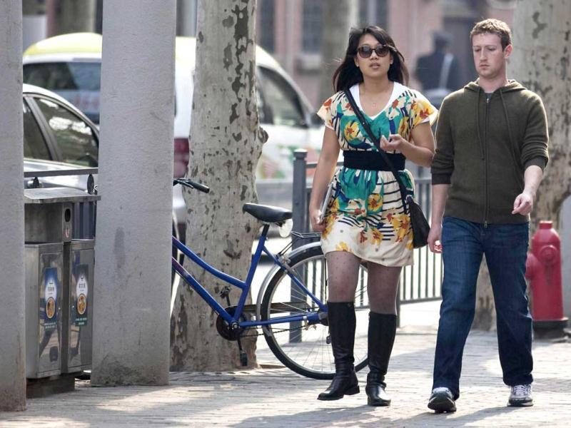 Facebook CEO Mark Zuckerberg and his girlfriend Priscilla Chan walk near Fuxing Road in Shanghai. Zuckerberg wed longtime girlfriend Chan announcing the nuptials through a status update on the social networking site. REUTERS/Stringer, Files