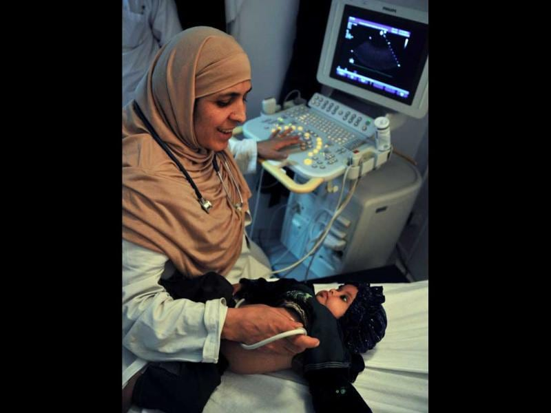Afghan cardiologist Rahima Stanikzair monitors an infant's heart at the French Medical Institute for Children in Kabul. When the Taliban ruled Afghanistan during 1996-2001, Rahima continued working, as male medical personel were banned from examining women. AFP/Bay Ismoyo