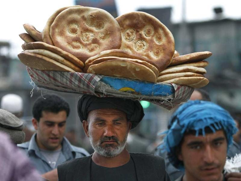 An Afghan street vendor carries bread in Kabul, Afghanistan. The Nan-i-Tandoori is made in a cylindrical clay oven. AP/Rahmat Gul