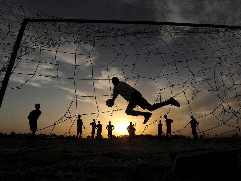Afghan youth play football in the evening in the city of Herat. AFP/Aref Karimi