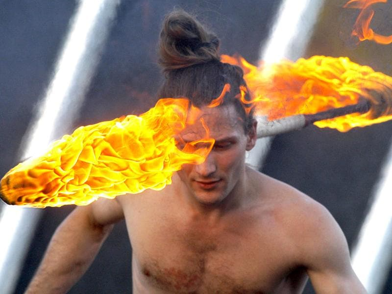 An artist turns fire around his neck as he takes part in a two-day fire festival in Minsk, Belarus. (AP Photo/Sergei Grits)