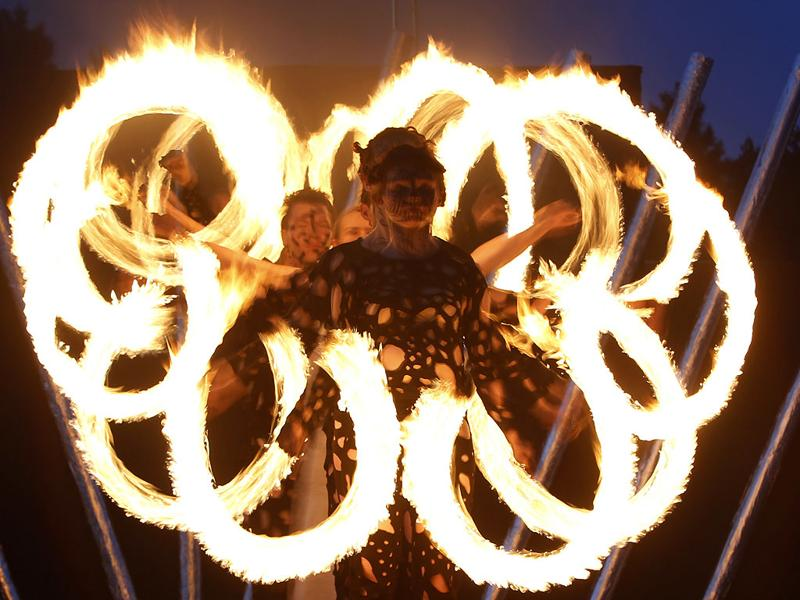 A performer makes a formation with fire in a two-day fire festival in Minsk, Belarus. (AP Photo/Sergei Grits)