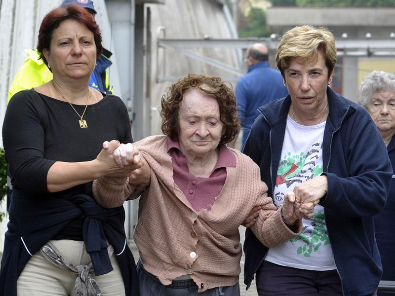 A woman who had to leave her home is assisted in Finale Emilia northern Italy, Sunday. A magnitude 6 earthquake shook northern Italy early Sunday at 4:04 a.m. Sunday between Modena and Mantova, about 35 kilometers (22 miles) north of Bologna at a relatively shallow depth of 10 kilometers (6 miles). (AP Photo/Marco Vasini)