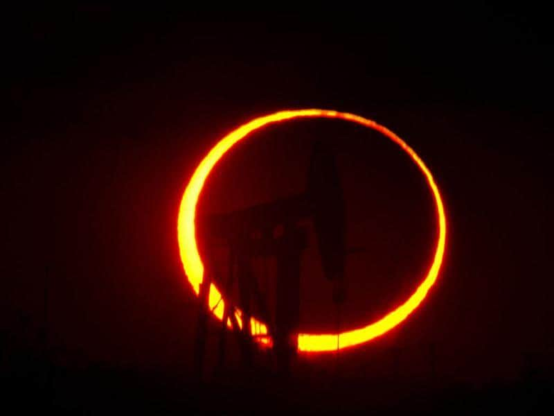 An annular eclipse appears north of Odessa, Texas. The annular eclipse, in which the moon passes in front of the sun leaving only a golden ring around its edges, was visible to wide areas across China, Japan and elsewhere in the region before moving across the Pacific to be seen in parts of the western United States. AP Photo/Odessa American, Albert Cesare