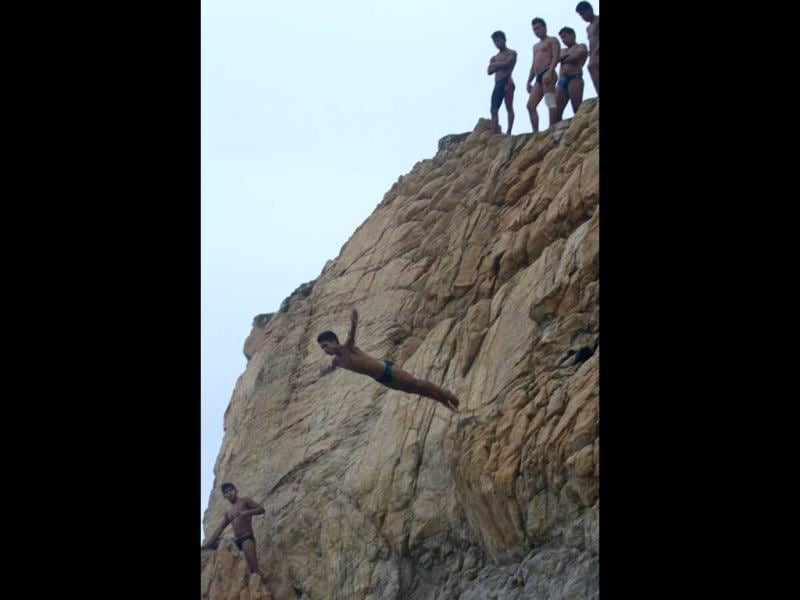 Bryant Ramirez, a 14 year-old cliff diver, jumps at La Quebrada in Acapulco, Mexico. The tradition of 'La Quebrada' goes back to 1934, when two neighbors of Acapulco challenged themselves to show their courage and decided to measure their forces by throwing themselves into the sea from the top of a cliff. AFP PHOTO/PEDRO PARDO