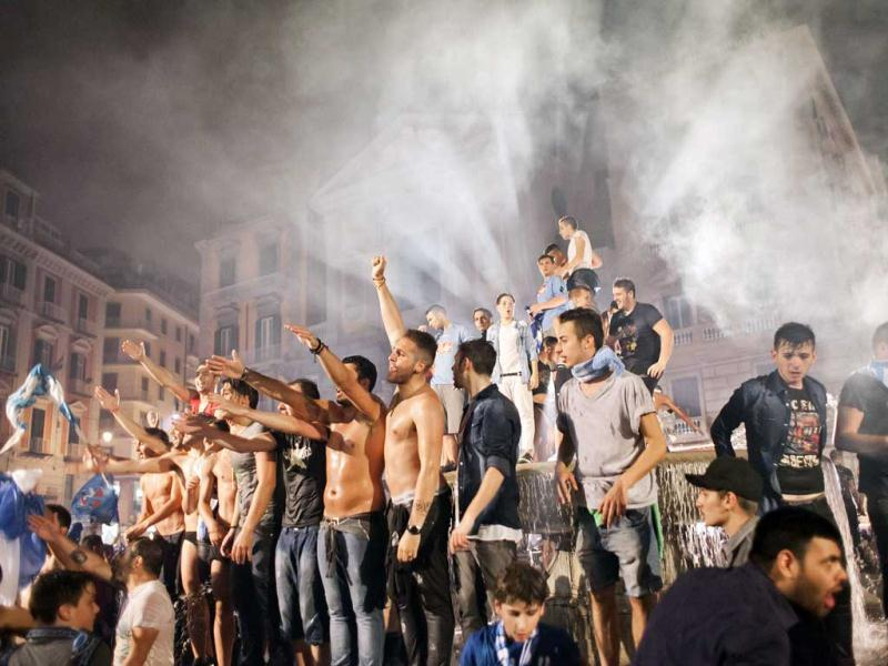 Napoli's football fans celebrate the victory of their team in Naples. AFP/Andrea Baldo