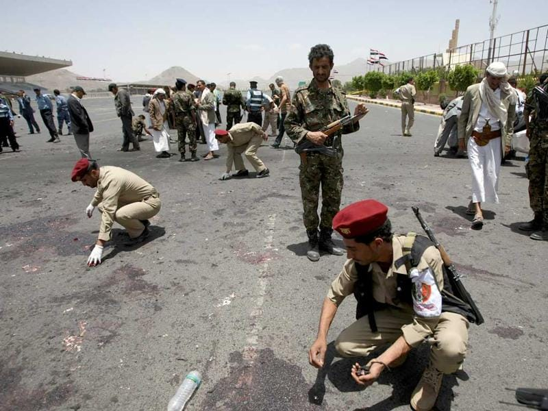 Yemeni military police collect evidence at the site of a suicide bomb attack in Sanaa. AFP/ Mohammed Huwais