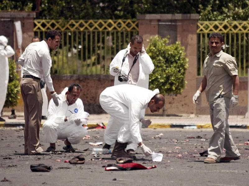 Forensic policemen collect evidence at the site of a suicide bomb attack at a parade square, killing some scores of people, in Sanaa. AP Photo/Hani Mohammed