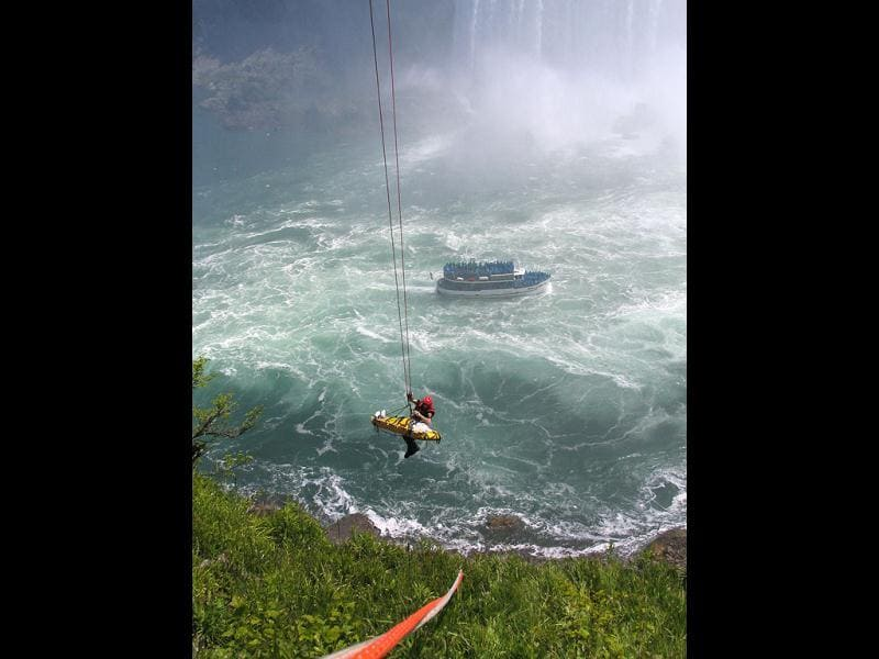 Niagara Falls emergency officials rescue a man who plunged over Niagara Falls and survived in an apparent suicide attempt. AP/Harry Rossetani