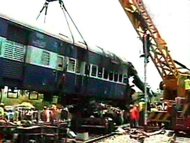 A TV grab shows a crane lifting a damaged coach of the Hampi Express which rammed into a stationary goods train at Penukonda station in Anantapur district of Andhra Pradesh.