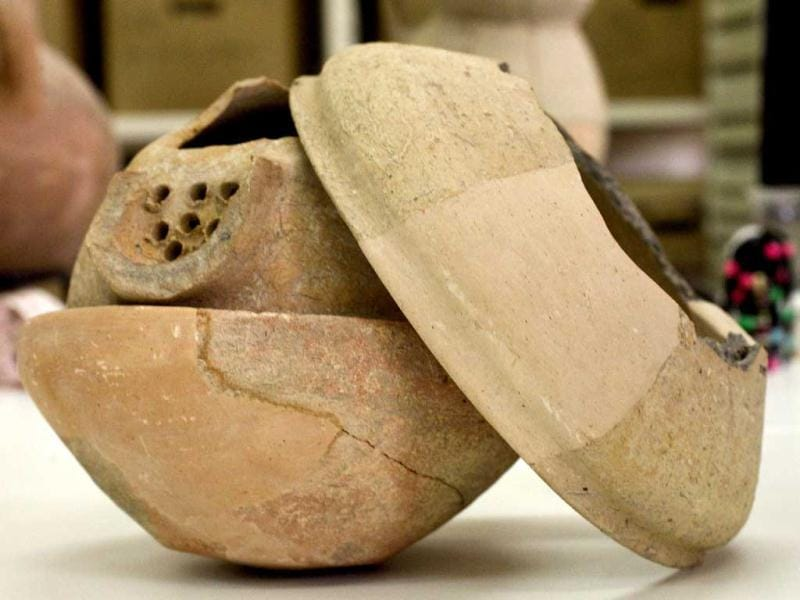 A recently discovered clay vessel that contained a collection of jewelery from the
