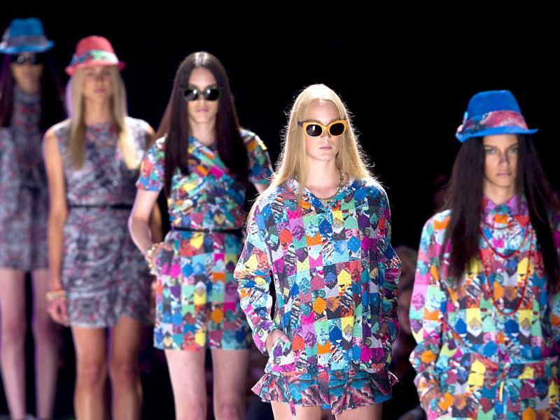 Models wear creations by Alessa summer collection during Fashion Rio in Rio de Janeiro, Brazil. AP Photo/Victor R. Caivano