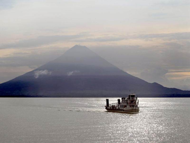 A ferry boat crosses Cocibolca Lake with the Concepcion Volcano in the background at Ometepe Island. Reuter Photo/Oswaldo Rivas