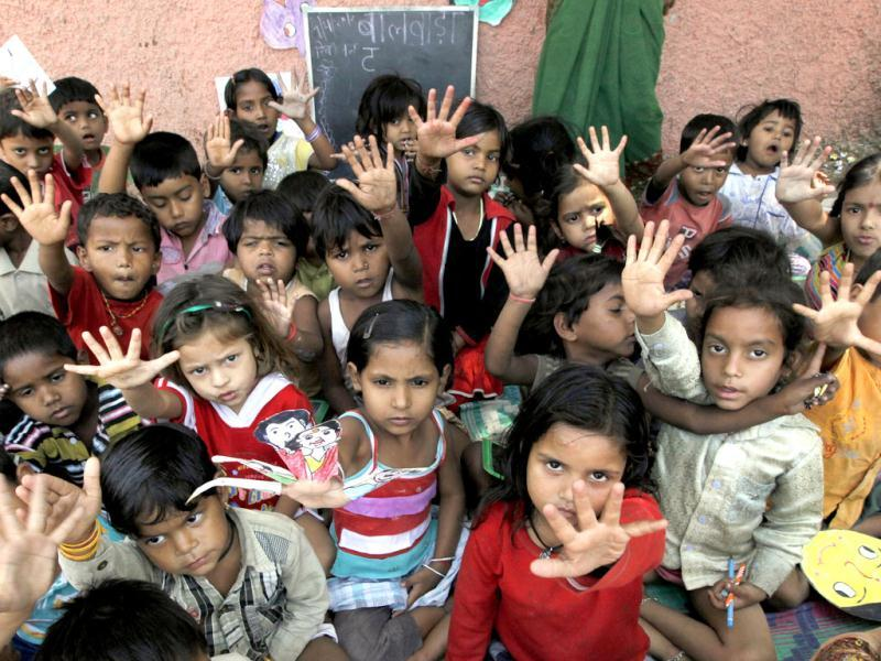 Children raise their hands at a Daya Basti creche in New Delhi. HT/Raj K Raj