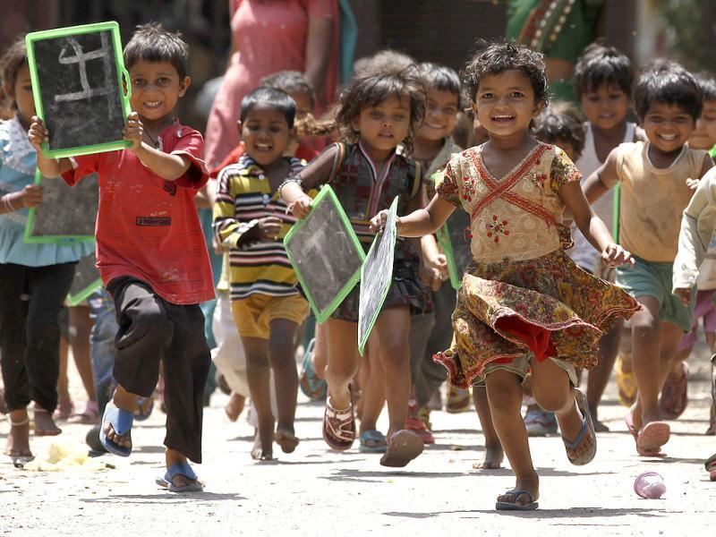 Children are seen running outside a creche in Daya Basti. HT/Raj K Raj