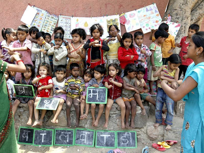 Children learn a new lesson at a creche in Daya Basti. HT/Raj K Raj