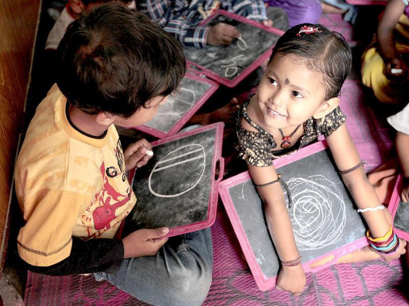Children attend a pre-school class under Pratham, an NGO, at Shashi Garden in East Delhi. HT/Ajay Aggarwal