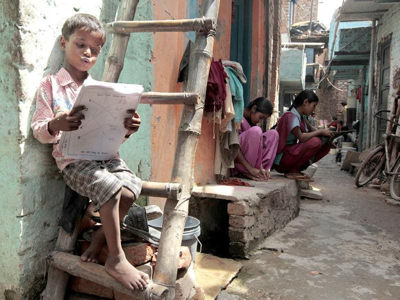 A child reads out from his book at a pre-school class under Pratham. HT/Ajay Aggarwal