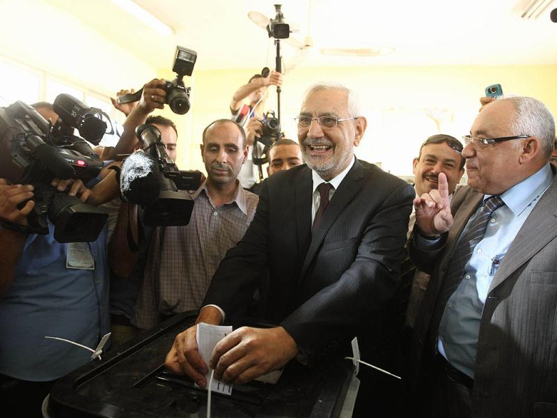 Egyptian moderate Islamist presidential candidate Abdel Moneim Abul Fotouh casts his ballot at a polling station in Cairo during the country's historic presidential election, the first since a popular uprising toppled Hosni Mubarak. AFP/Khaled Desouki