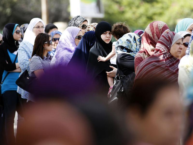 Egyptian women line up outside a polling station to cast their votes during the first day of the presidential elections in Alexandria, Egypt. AP/Khalil Hamra
