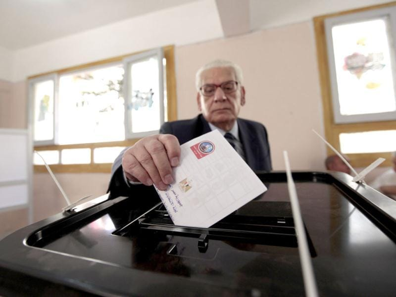 A man casts his vote at a polling station during presidential elections in Alexandria, 230 km (140 miles) north of Cairo. Reuters/Mohamed Abd El-Ghany