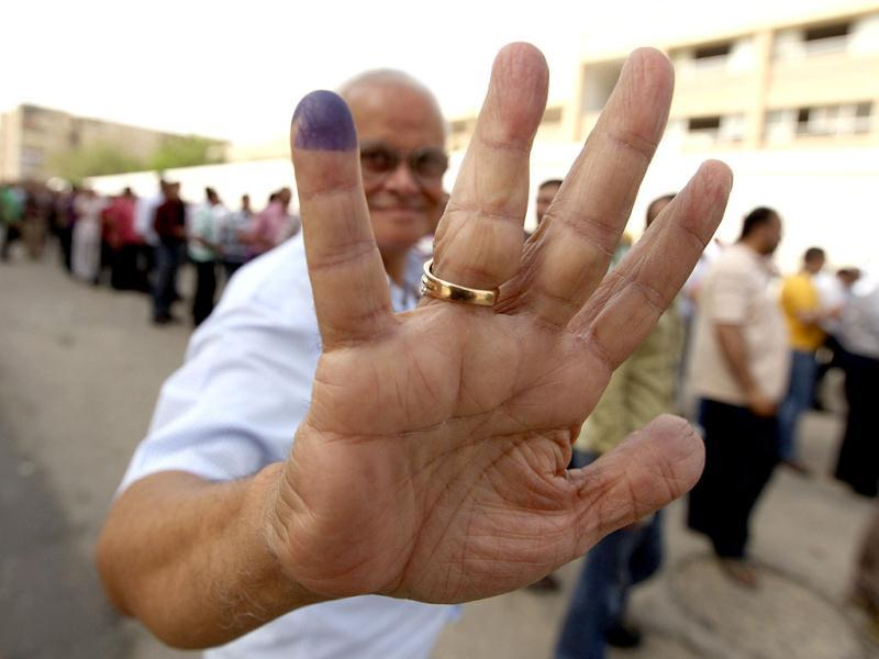 A man shows his finger after casting his vote at a polling station in Cairo. Egyptians vote freely for the first time to pick their president in a wide open election that pits Islamists against men who served under deposed leader Hosni Mubarak. Reuters/Amr Abdallah Dalsh
