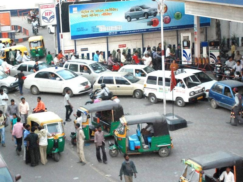 People line up to fill their vehicles at an oil pump after the announcement of hike in petrol prices, in Ghaziabad. PTI photo