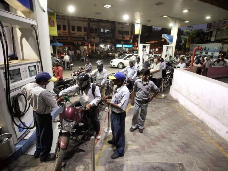 People line up to fill their vehicles at an oil pump in Lucknow after the announcement of hike in petrol prices. PTI/Nand Kumar