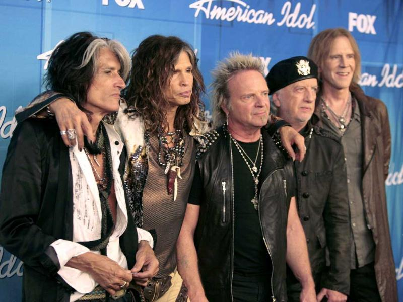 The members of Aerosmith, including lead singer Steven Tyler (2nd from L), pose backstage after performing during the 11th season finale of American Idol in Los Angeles. Reuters Photo/Jason Redmond