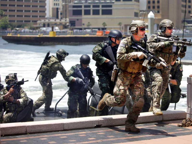 Special Operations Forces (SOF) demonstrate their combined combat capabilities outside the Tampa Convention Center during a conference of SOF delegates from 96 nations in Tampa. AP Photo