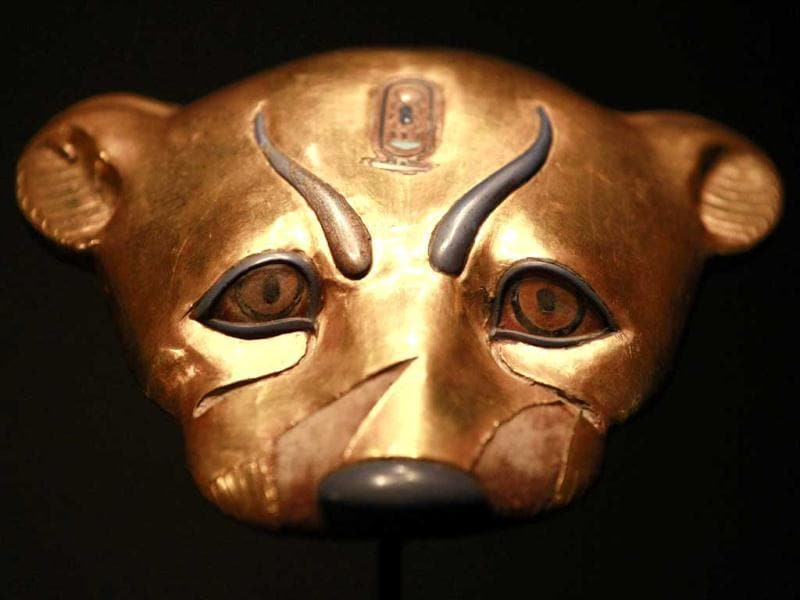 A golden leopard head statue is displayed during a preview of a King Tut exhibit. AP/Elaine Thompson
