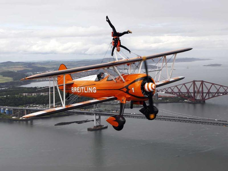 Team Breitling wingwalker Charlotte Voce performs, in advance of their appearance at an airshow at the National Museum of Flight at East Fortune, over the Firth of Forth in Scotland. Reuters/David Moir, Files