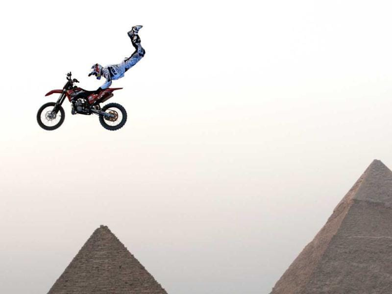 A biker performs in front of the Great Giza pyramids during Red Bull Fighters International Freestyle Motocross Exhibition Tour on the outskirts of Cairo. Reuters/Goran Tomasevic, Files