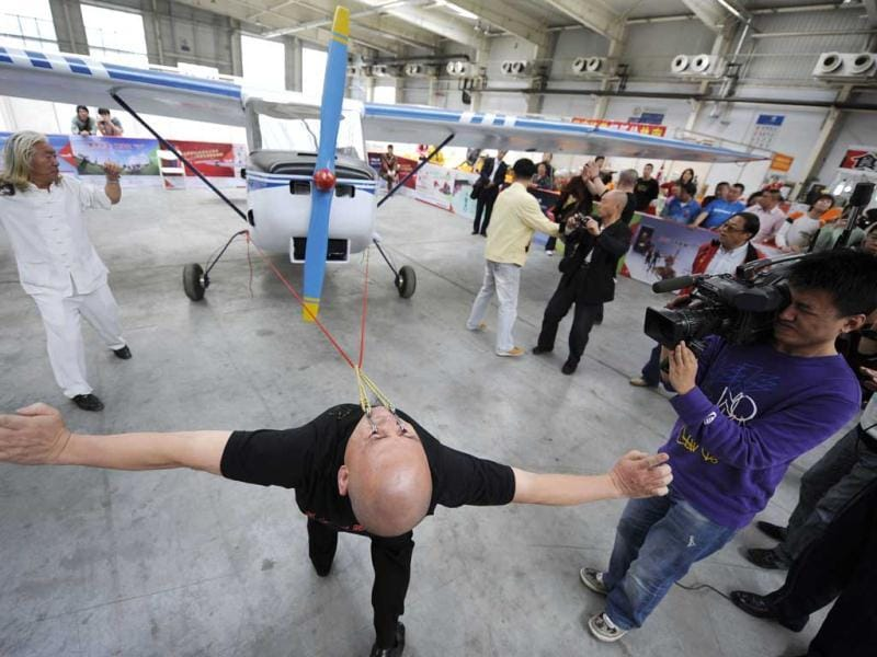Stuntman Dong Changsheng pulls a 560 kg (1235 pounds) plane with his eyelids during a cultural festival in Changchun, Jilin province. Dong, a martial art enthusiast for more than 30 years, pulled the plane about 5m (16 ft) during the performance, local media reported. Reuters/Stringer, Files