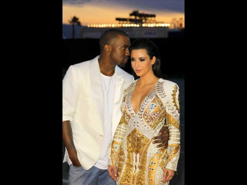 Kanye West and girlfriend Kim Kardashian were spotted at the Cannes film festival red carpet as the rapper debuted his short film Cruel Summer.