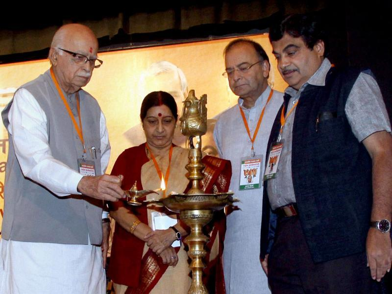 Senior BJP leader LK Advani with Nitin Gadkari, Sushma Swaraj and Arun Jaitley lights the lamp during the inauguration of the party's National Executive Meeting in Mumbai. PTI/Mitesh Bhuvad
