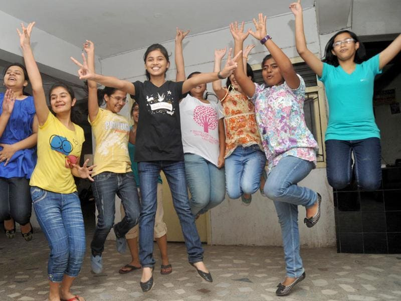 Students who passed the CBSE 10th standard exams celebrate in Patna.