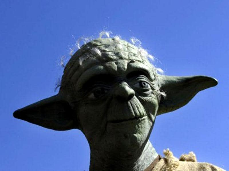 A fan dressed as Star wars character Yoda takes part in a meeting in Santiago de Compostela, northwestern Spain, on May 21, 2010, to conmemorate the 30th anniversary of