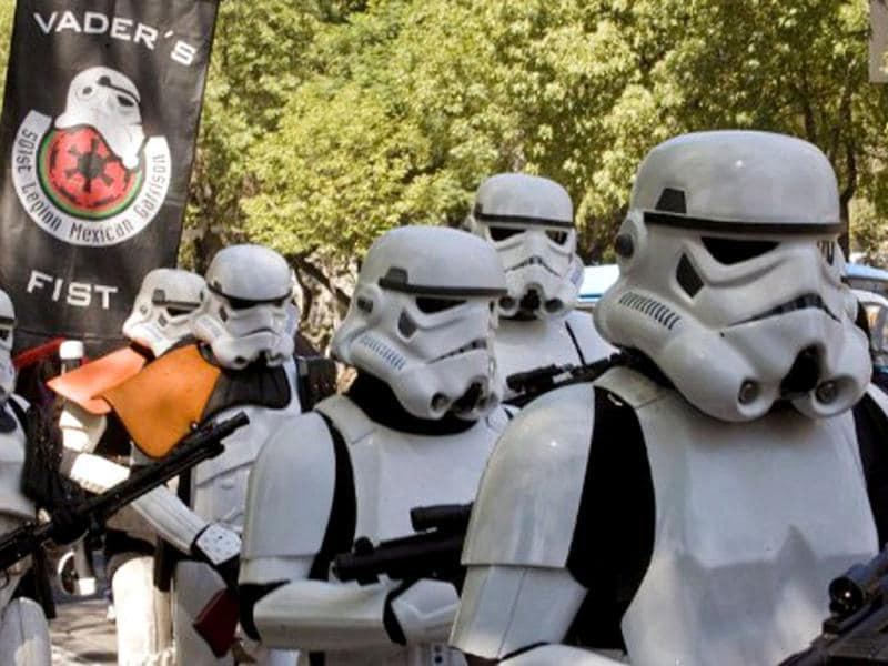 Fans dressed like Stormtroopers, Star Wars movie characters take part in a demonstration to celebrate the Blu Ray edition of the Star Wars saga, at the Reforma Avenue in Mexico City, on September 10, 2011. AFP/Alfredo Estrella