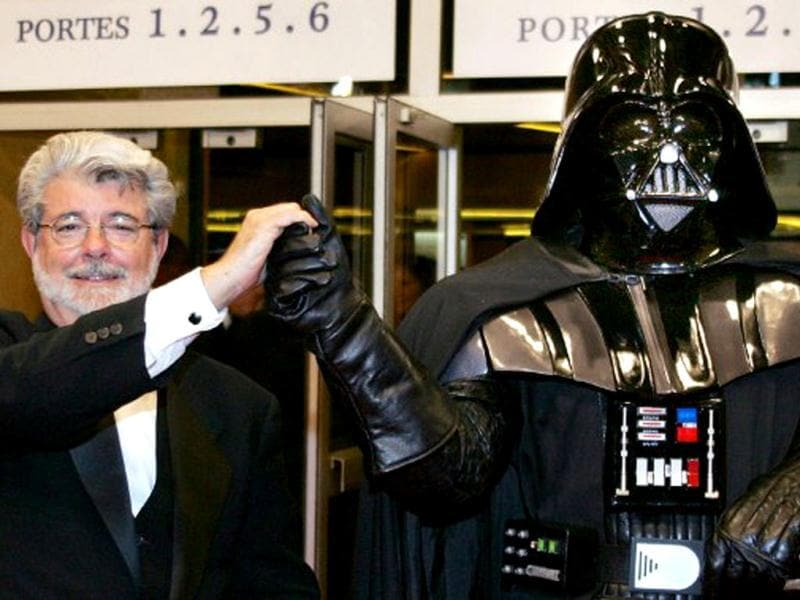 US director George Lucas (L) poses with Darth Vader at the end of the screening of his film