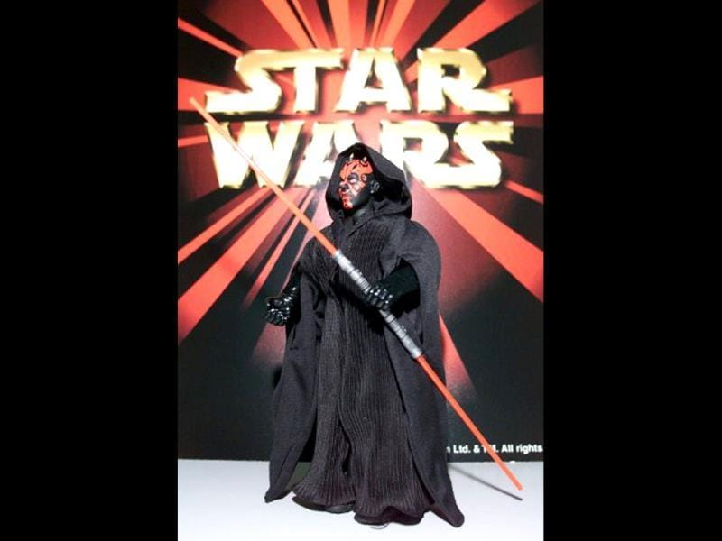 A toy of Star Wars character Darth Maul is shown holding a light saber in Kuala on Lumpur 28 May 1999. AFP/Jimin Lai