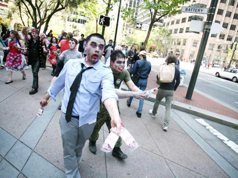 Zombies stalked San Francisco streets as social game maker Zynga ghoulishly introduced a game that lets iPhone or iPod Touch users slash and hack the undead. AFP PHOTO / Kimihiro Hoshino