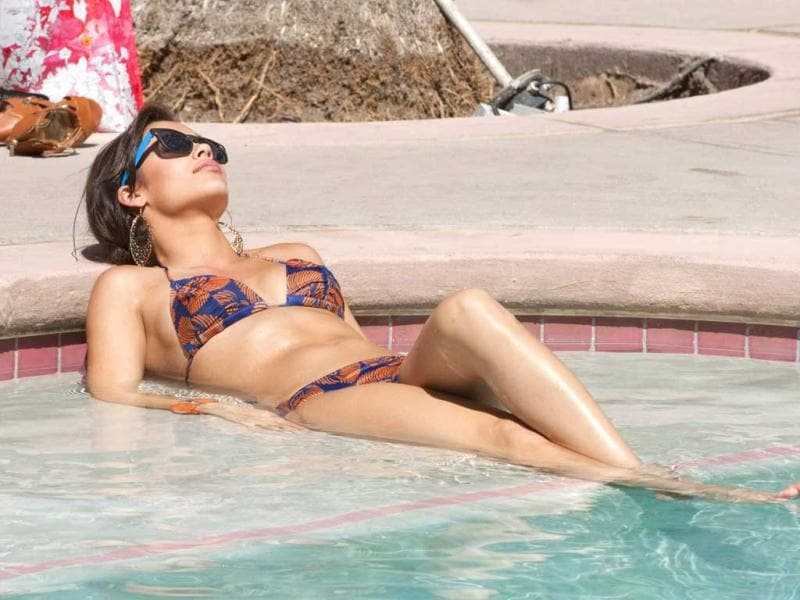 Miss Mississippi USA 2012, Myverick Rashea Garcia, relaxes in the pool during the OPTX Rhode Island pool party at the Flamingo Hotel in Las Vegas, Nevada. (AFP Photo)