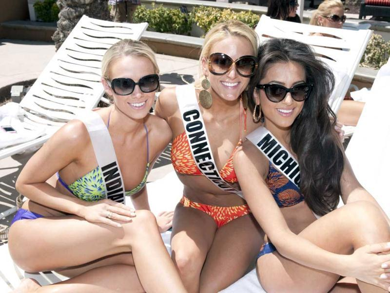 Miss Indiana USA 2012, Megan Myrehn; Miss Connecticut USA 2012, Marie-Lynn Piscitelli; and Miss Michigan USA 2012, Kristen Samantha Danyal; pose for a photo in their Kooey Australia Swimwear during the OPTX Rhode Island pool party at the Flamingo Hotel in Las Vegas, Nevada. (AFP Photo)