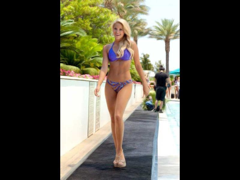 Miss Kansas USA 2012, Gentry Linn Miller, walks the runway in her Kooey Swimwear during the Kooey Swimwear Fashion Show featuring the Miss USA 2012 Contestants at the Trump Tower in Las Vegas, Nevada. (AFP Photo)
