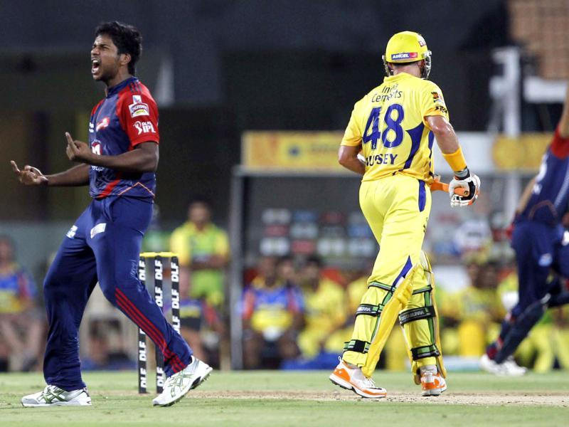 Delhi Daredevils bowler Varun Aaron celebrates the wicket of Chennai Super Kings batsman Mike Hussey during the IPL Qualifier 2 match at MA Chidambaram stadium in Chennai. HT/Santosh Harhare