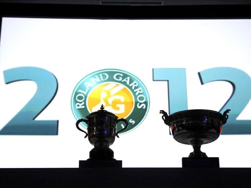 The women's (L) and men's trophies are displayed during the draw ceremony for the French Open tennis tournament at the Roland Garros stadium in Paris, two days ahead of the start of the tournament. Reuters/Benoit Tessier