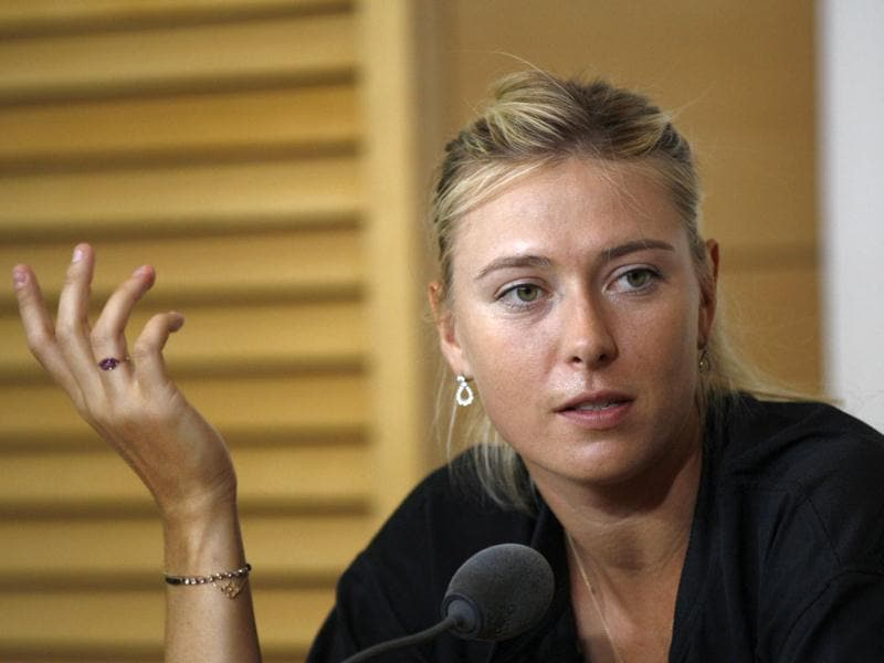 Russi'a Maria Sharapova answers reporters during a press conference for the French Open tennis tournament at the Roland Garros stadium in Paris. AP Photo/Bertrand Combaldieu