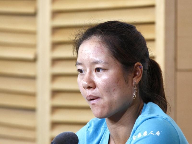 Defending champion Na Li answers reporters during a press conference for the French Open tennis tournament at the Roland Garros stadium in Paris. AP Photo/Bertrand Combaldieu