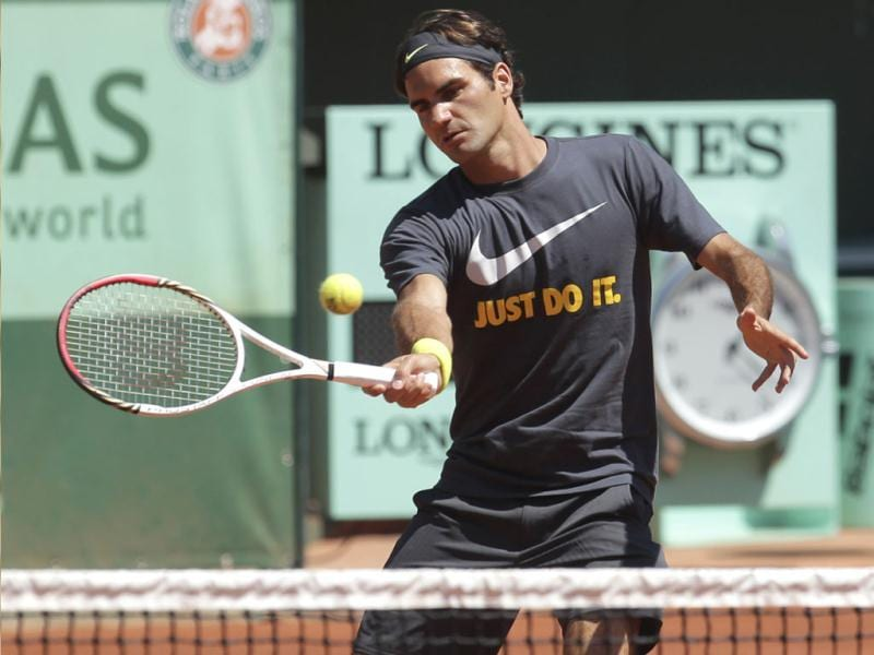 Switzerland's Roger Federer returns the ball as he trains for the French Open tennis tournament at the Roland Garros stadium in Paris. AP Photo/Michel Euler